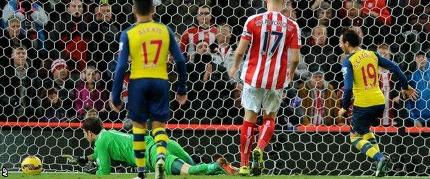 Arsenal's Santi Cazorla scores