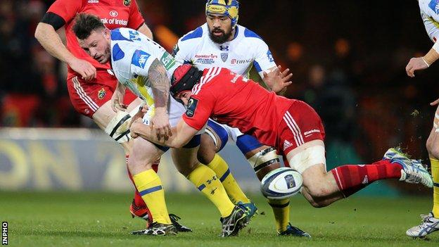 Munster's Tommy O'Donnell tackles Clermont's Thomas Domingo at Thomond Park