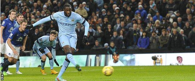 Manchester City midfielder Yaya Toure scores from the penalty spot against Everton
