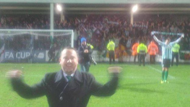 Mark Carruthers celebrates Blyth's win on the pitch