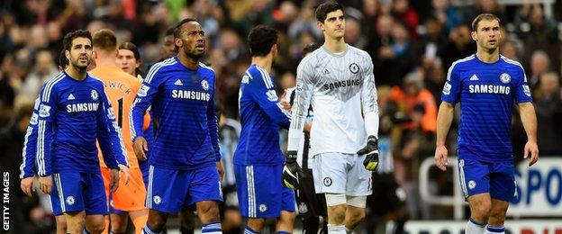 Chelsea's players react after losing 2-1 at Newcastle
