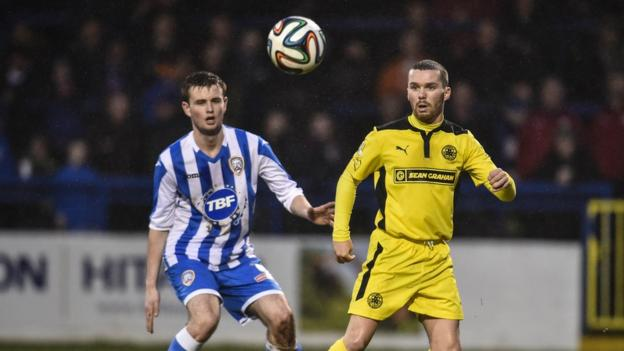 Adam Mullan and Martin Donnelly keep their eyes on the ball as Cliftonville go down to Coleraine