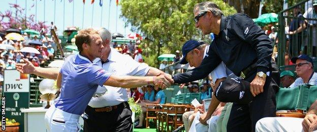 Dany Willett shakes hands with Gary Player before teeing off in the final round