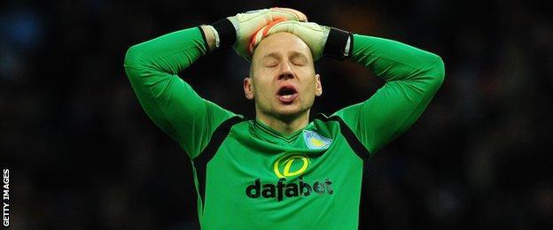 Aston Villa goalkeeper Brad Guzan reacts during his team's game with Leicester