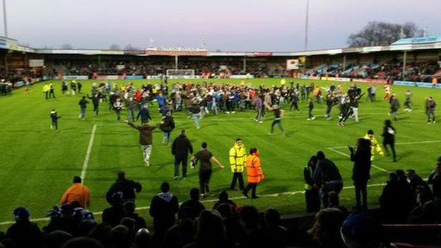 Paul Jones captures the Worcester City fans pitch invasion at Scunthorpe