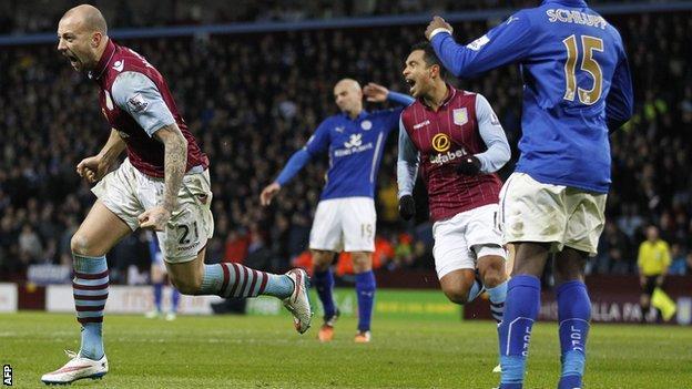 Alan Hutton celebrates scoring for Aston Villa against Leicester City