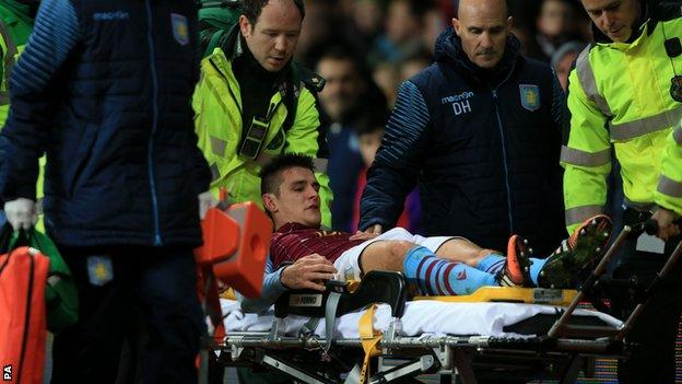 Ashley Westwood is stretchered off at Villa Park
