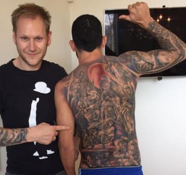 Carlos Tevez's back tattoo