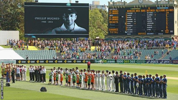 Players stand for 63 seconds of applause in memory of Phillip Hughes