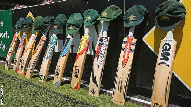Bats and caps are left out in memory of the late Phillip Hughes