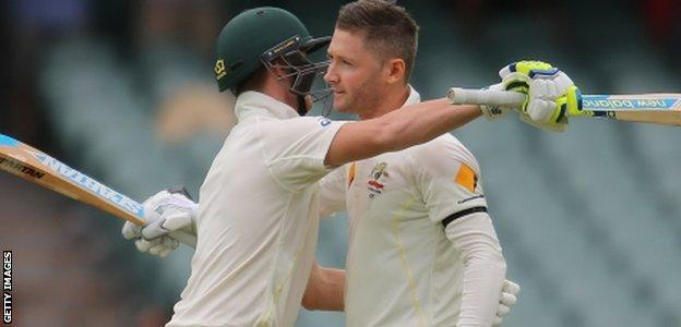 Clarke is embraced by Smith