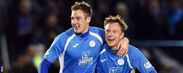 Kevin Holt (left) celebrates putting Queen of the South 1-0 ahead against Rangers on Friday