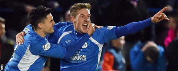 Kevin Holt (right) celebrates after putting Queen of the South ahead