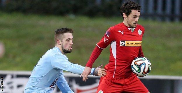 Institute's Robbie Hume closes in on Tomas Cosgrove of Cliftonville