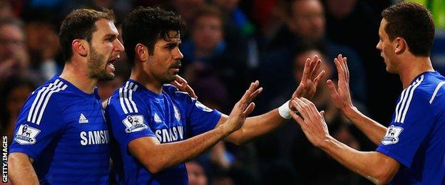 Diego Costa (centre) celebrates