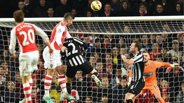 Olivier Giroud heads Arsenal ahead against Newcastle United