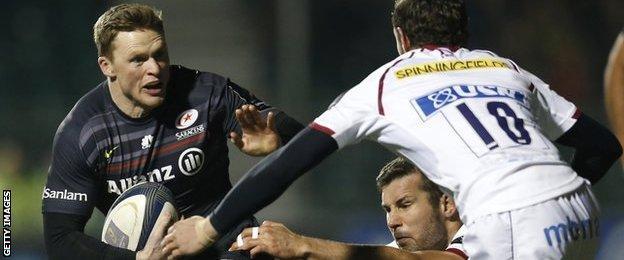 Saracens wing Chris Ashton takes on Sale fly-half Nick Macleod