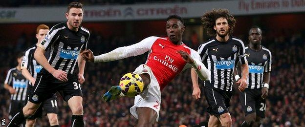Danny Welbeck has a shot for Arsenal against Newcastle United