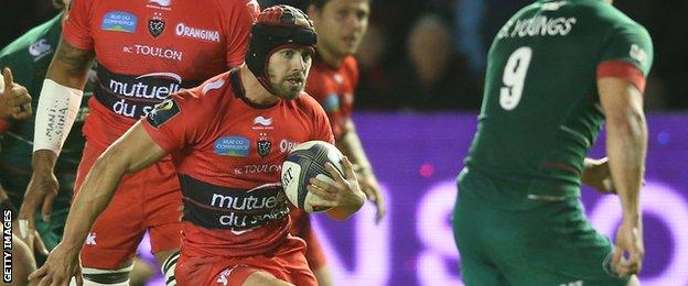 Leigh Halfpenny takes on Leicester's Ben Youngs