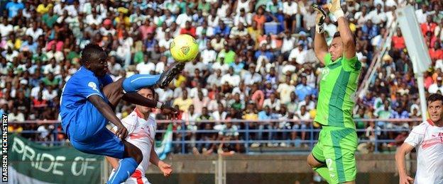 Alhassan 'Crespo' Kamara chips the keeper vs Tunisia