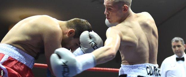 Joe Ham lands a left hook to end the fight