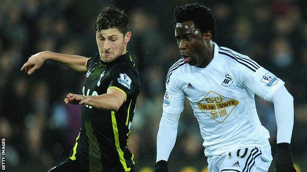 Ben Davies in action against Wilfried Bony