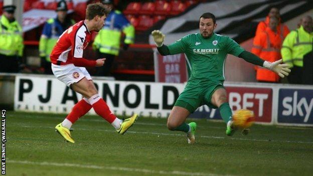 Tom Bradshaw slots his 10th goal of the season for Walsall against Barnsley