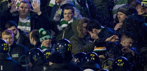 Police move in among the Celtic fans