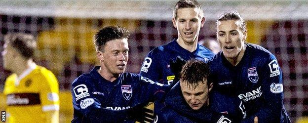 Ross County celebrate their late equaliser at Fir Park