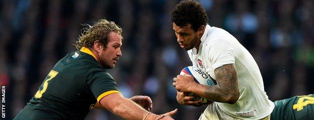 Courtney Lawes takes on South Africa's Jannie Du Plessis