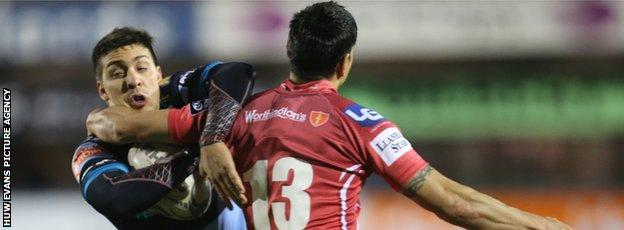 Cardiff Blues' Lucas Amorosino is stopped by Scarlets' Regan King