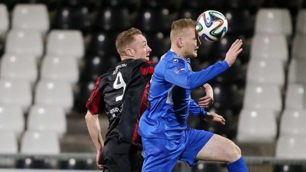 Timmy Adamson and David Armstrong in aerial action as Crusaders beat Dungannon Swifts 1-0 on Friday night to maintain their Premiership challenge