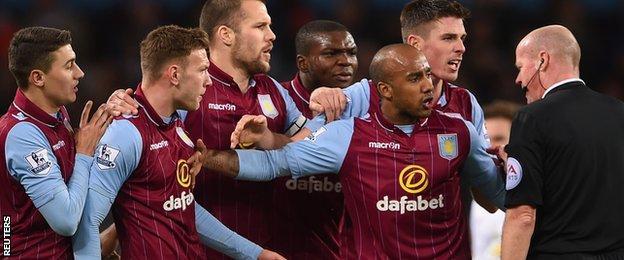 Aston Villa's players protest