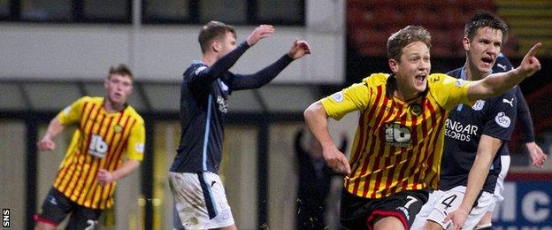 James Craigen celebrates after scoring for Partick Thistle against Dundee