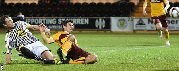 Motherwell's John Sutton slides in to score the winning goal