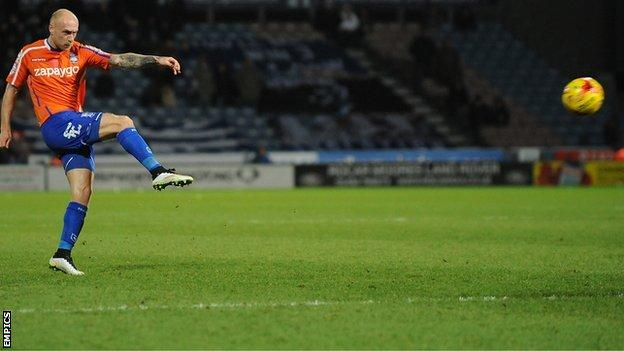 David Cotterill (left) scores the winner against Huddersfield
