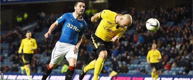 Livingston's Simon Mensing scores an own goal in the match against Rangers