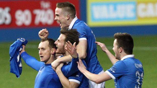 Sammy Morrow is mobbed by Linfield team-mates after firing home the winning goal to send his side four points clear at the top