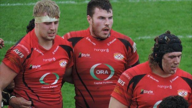 Jersey prepare for the scrum against Carnegie
