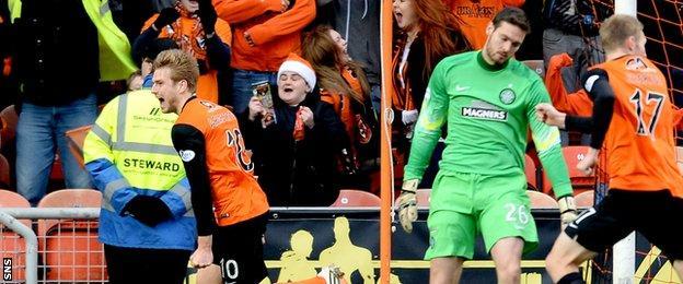 Stuart Armstrong (left) celebrates after scoring for Dundee United against Celtic