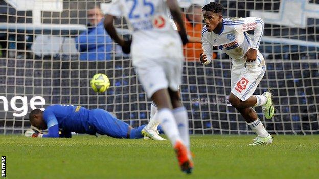 Marseille forward Michy Batshuayi (right) wheels away to celebrate his side's winner against Lille