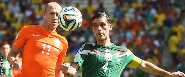 Netherlands' Arjen Robben and Mexico's Rafael Marquez