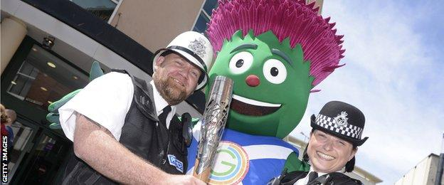 The Commonwealth Games mascot with two police officers