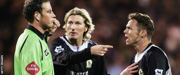 Blackburn duo Robbie Savage and Paul Dickov , and referee Mark Clattenburg