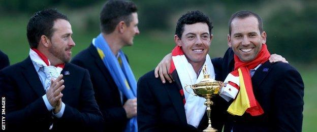 Rory McIlroy and Sergio Garcia pose with the 2014 Ryder Cup trophy