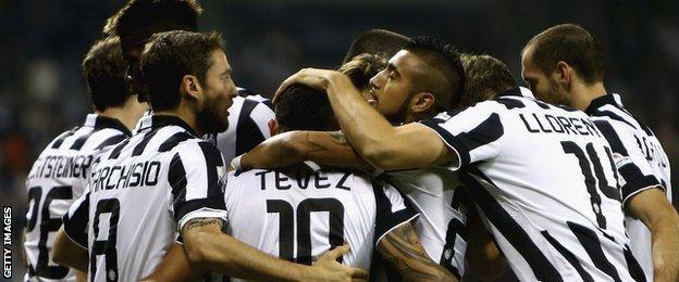 Juve players celebrate Carlos Tevez's opening goal