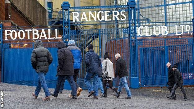 Rangers fans turn up at a wet Ibrox for the club's annual general meeting