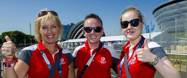 All smiles from Glasgow 2014 Commonwealth Games volunteers Lesley Smith, Michael Riley and Ellie McCarthur