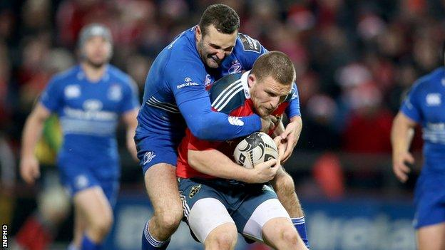 Leinster wing Dave Kearney battles with Munster try-scorer Andrew Conway