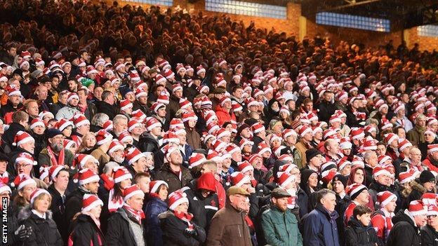 Southampton supporters in Father Christmas hats at Selhurst Park